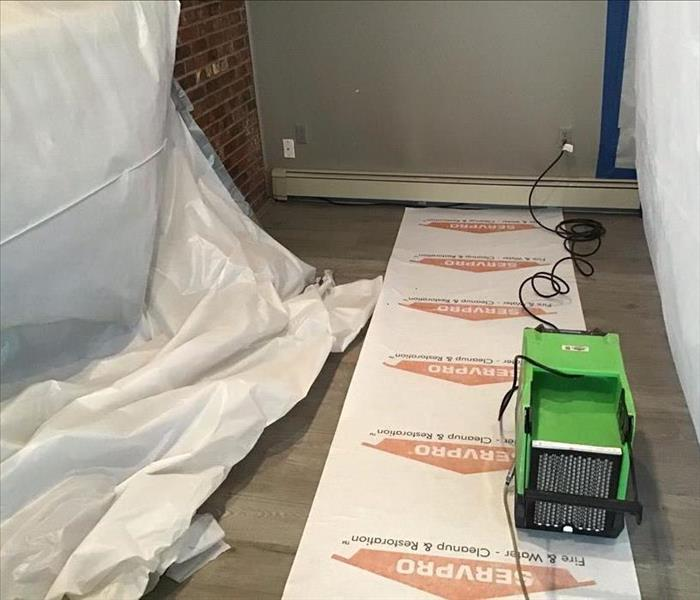 SERVPRO equipment on walking strip in room