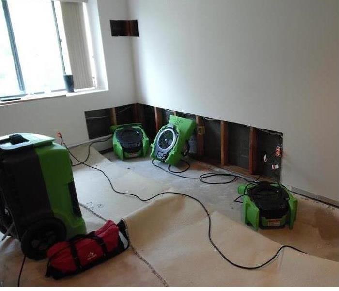 dryers placed in a room after a flood