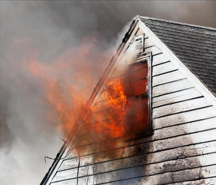 active fire burning in attic of a house